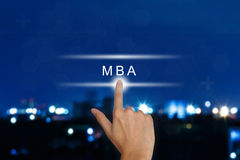Hand pushing The Master of Business Administration (MBA or M.B.A.) button on touch screen. Hand clicking The Master of Business Administration (MBA or M.B.A.) royalty free stock photo