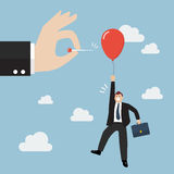 Hand pushing needle to pop the balloon of rival. Business competition concept Royalty Free Stock Images