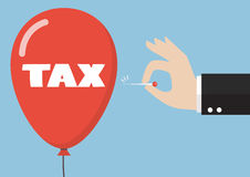 Hand pushing needle to pop the tax balloon Stock Photography