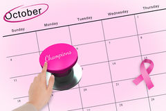 Hand pushing pink button for breast cancer awareness Royalty Free Stock Image