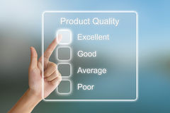Hand pushing product quality on virtual screen Stock Photo