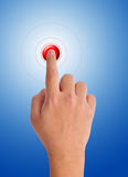 Hand pushing a red button Stock Photography