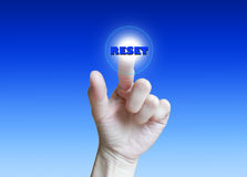 Hand pushing reset on touchscreen button. Hand pushing reset on circle touchscreen button Royalty Free Stock Image
