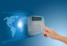 Hand pushing safe button. With blue background with map Stock Photo