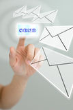 Hand pushing the send button for send the mail Royalty Free Stock Image