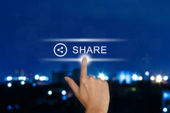Hand pushing share button on touch screen. Hand clicking share button on a touch screen interface Royalty Free Stock Image