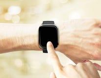 Hand pushing smartwatch Royalty Free Stock Photos