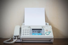 A hand pushing start button old fax Stock Photos