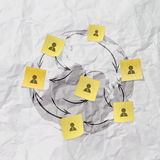 Hand pushing sticky note social network on crumpled paper Royalty Free Stock Photo