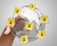 Hand pushing sticky note social network icon on crumpled paper b Royalty Free Stock Photo