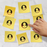 Hand pushing sticky note social network icon Stock Photos