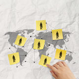 Hand pushing sticky note social network icon. On crumpled paper background as concept royalty free illustration