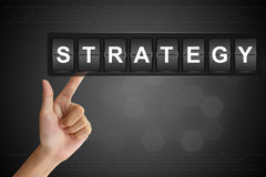 Hand pushing strategy on Flip Board Stock Image