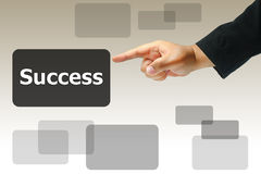 Hand pushing success button Stock Photo
