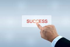 Hand pushing SUCCESS button Royalty Free Stock Images
