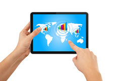 Hand pushing tablet with blue earth map Stock Image