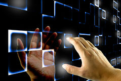 Hand pushing on a touch screen Royalty Free Stock Photos