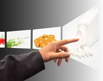 Hand pushing a touch screen interface Royalty Free Stock Image