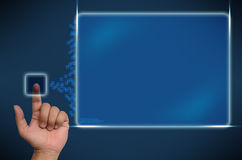 Hand pushing on a touch screen interface. Expand it present Stock Photos
