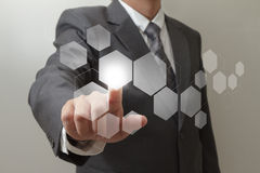 Hand pushing on  touch screen interface Royalty Free Stock Image