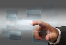 Hand pushing touch screen interface Stock Photography