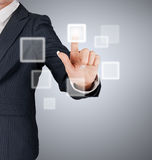 Hand pushing on a touch screen interface Royalty Free Stock Photos