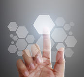 Hand pushing on touch screen interface Royalty Free Stock Photo