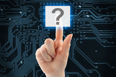 Hand pushing virtual question button Stock Image