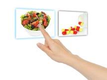 Hand pushing virtual salad Stock Image