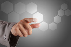 Hand pushing on a virtual touch screen interface royalty free stock photo