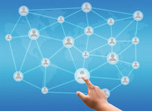 Hand pushing visual screen with global network communication Stock Image