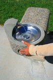 Hand Pushing Water Fountain Royalty Free Stock Photos