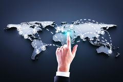 Hand pushing world map Royalty Free Stock Images