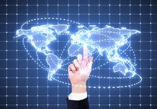 Hand pushing world map Stock Photography