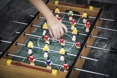 Focus ball in start soccer table game. Boy toy sport game concep. Hand put ball in start soccer table game. Boy toy sport game concept. Soccer table is relax Stock Image