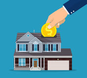 Hand put coin in piggy bank house. Vector illustration in flat style Royalty Free Stock Photography