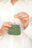 Hand put coin in purse Stock Photography