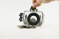 Hand put coin saving in safe box Royalty Free Stock Photography