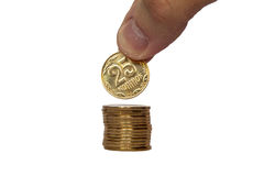 Hand put coin on a stack of coins money value buisness finance. Hand put coin on a stack of coins Royalty Free Stock Photo