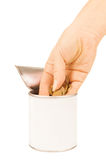 Hand put coin in tin with Royalty Free Stock Photos