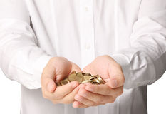 Hand put coin to money Royalty Free Stock Photography