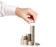 Hand put coin to money Stock Photos