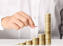 Hand put coin to money Stock Photography
