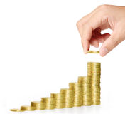 Hand put coin to money Royalty Free Stock Photos