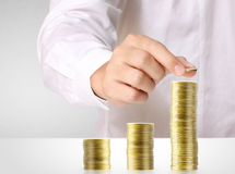 Hand put coin to money ,Business idea Stock Images