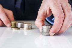 Hand put coin to stack Stock Photos