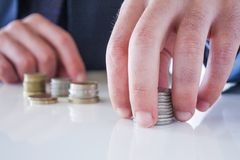 Hand put coin to stack Royalty Free Stock Photography