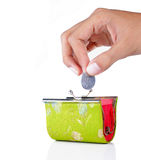 Hand put coin into the wallet Royalty Free Stock Image