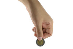 Hand put coins isolated on white. Royalty Free Stock Images