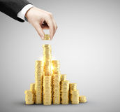 Hand put coins. To money staircase Royalty Free Stock Images